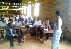 Ms.-Joseline-Nyangoma-the-District-Environmental-Officer-addressing-participants-300x206